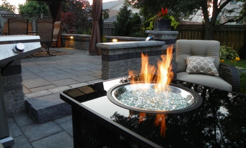 Fire and water bring peace to outdoor setting