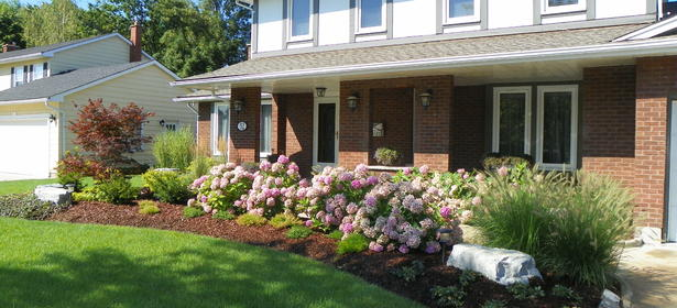 Custom designed residential front plantings with Armour Stone accents