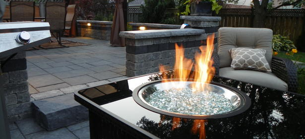 Natural gas burning fire table installed on an outdoor patio